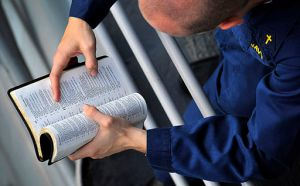 Chaplain_Lt._Jason_Gregory_reads_bible