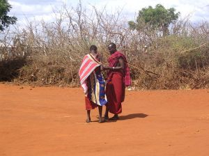 Maasai_people_in_a_village_on_the_A109_road,_Kenya