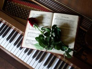 Rose-on-hymnal-on-piano