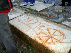 An early Christian ichthys symbol carved into some marble in the ruins of Ephesus, Turkey.