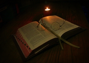 Bible-candle-light-reading-1439638-m